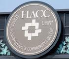 HACC on overhead sign at Hbg Main Entrance