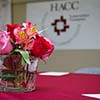 Flowers and HACC logo
