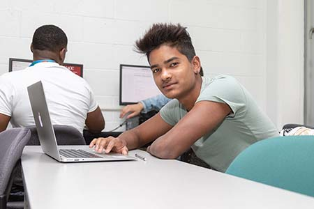 Photo of student at laptop